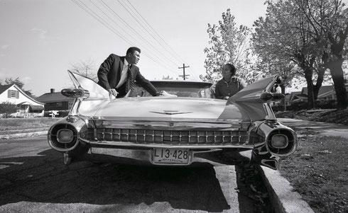 Muhammad Ali, shows off a new pink Cadillac to his mother Odessa Clay. He bought the automobile for his parents following his first professional fight in 1960. (Jean A. Baron, The Courier-Journal, USA TODAY Sports)