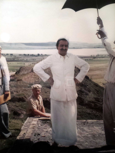 Baba inspecting building works on the hill. Kumar is holding the umbrella with Francis behind Baba