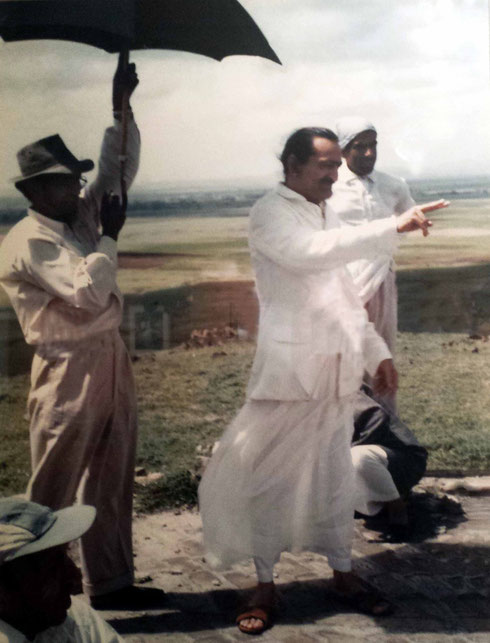 Baba inspecting building works on the hill. Kumar is holding the umbrella with Krishna Nair at the rear.