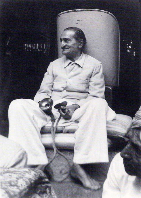 """7th November 1954 : Meher Baba accompaning a Kirtans musical performance in his honour at Nananand's dharamshala. Photo taken by B. Panday. Courtesy of Lord Meher ; 1st Ed. Vol.13-14, p.4574. Also in """"The Beloved"""" book p.73."""