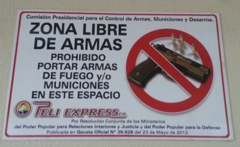 A sign in one of Venezuela's premises, prohibitting fire weapons and ammunition