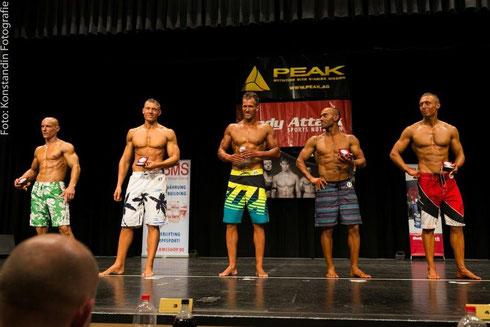 Die Top 5 der Männer-Physique-Klasse (v. l. n. r.): Sergej Löwen (5.), Alex Ricker (3.), Daniel Rüschenschmidt (1.), Ali Jad Ghadban (2.), Alexander Gross (4.)