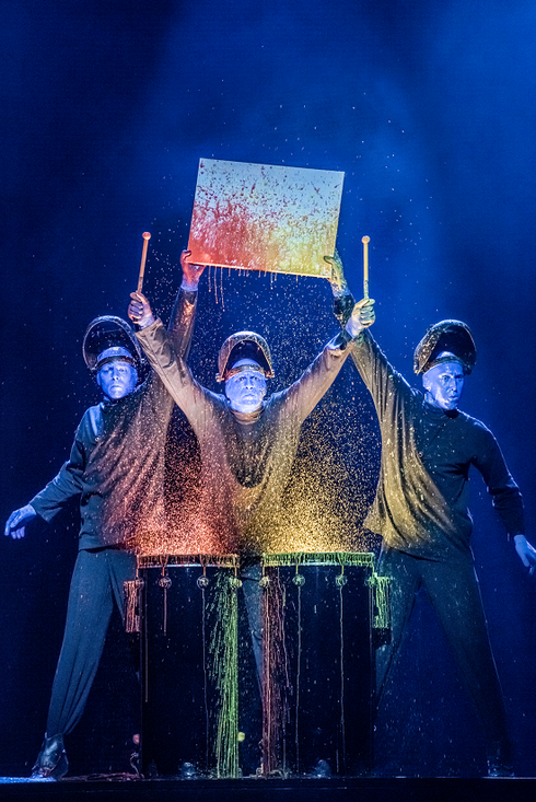 Blue Man Group drumming as paint flies - Photo by Lindsey Best