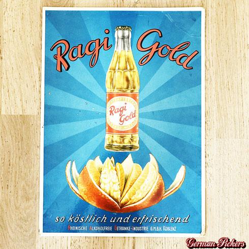 Ragi Gold - Pappschild  Rheinische Alkoholfreie Getränke-Industrie Koblenz GmbH Koblenz  Vertrieb durch Königsbacher Brauerei  Koblenz um 1960  50 × 33 cm
