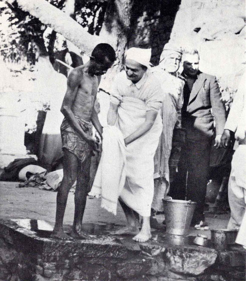 "7th November 1954 : Meher Baba at the leper colony in Pandharpur, drying a leper with Saint Gadge Maharaj & Meherjee Karkaria ( behind Baba ). Photo by B. Panday. Courtesy of N.Anzar's ""The Beloved"" book - p.72."