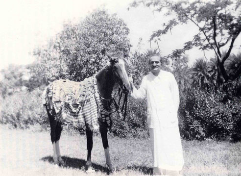 Meher Baba with Sheba in Satara in 1956. Image is courtesy of Lord Meher.