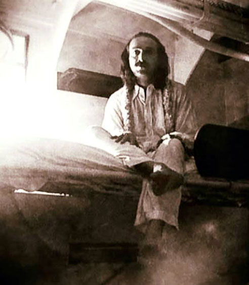 Meher Baba in his cabin on an unknown ship.