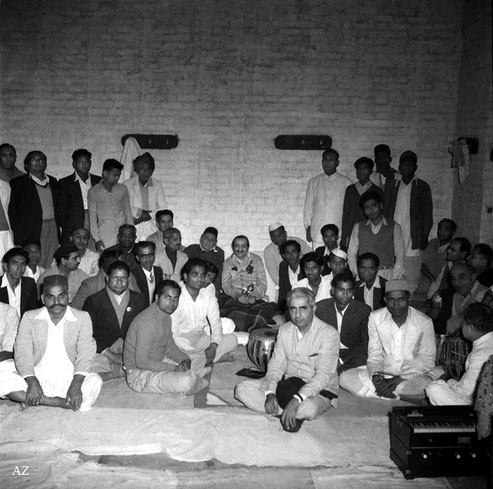 6th Nov.  Meher Baba at the School Residence, all night gathering listening to singing and music.