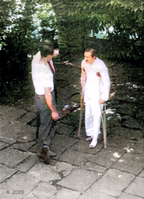 Meher Baba getting therapy advice from Dr. Donkin at Locarno. Image colourized by Anthony Zois. Trimmed image..
