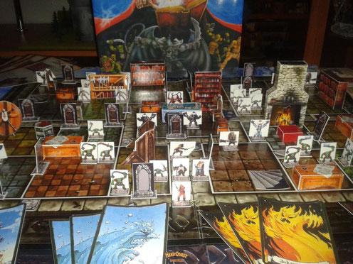 Le jeu Heroquest avec des figurines et des meubles réalisés en papier....