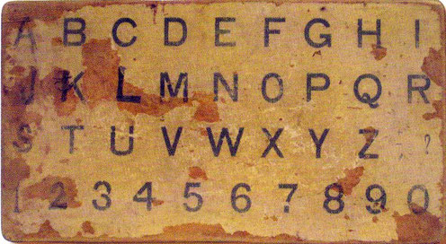 Meher Baba's alphabet board made on June 10, 1939 and used by him till 1941. Beloved Archives Collection, NJ.