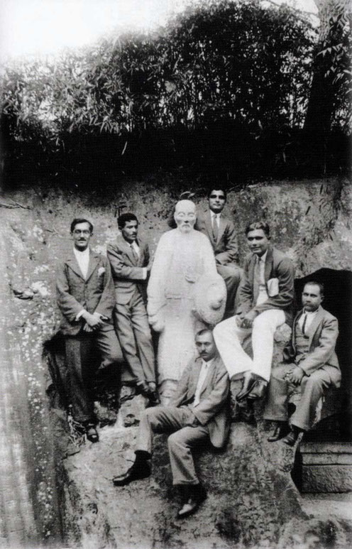 China, 1932 - Men mandali at the statue of Deng Shiru and his cave in Hangzhou, China, prior to Meher Baba's visit.