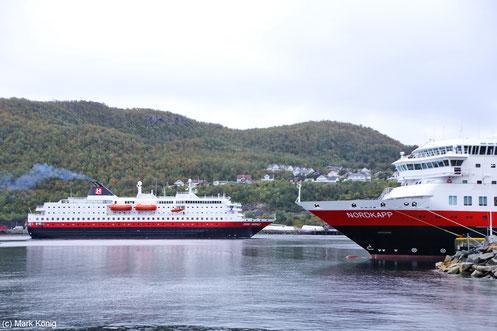 Two Hurtigruten coastal vessels meet in the port of Harstad