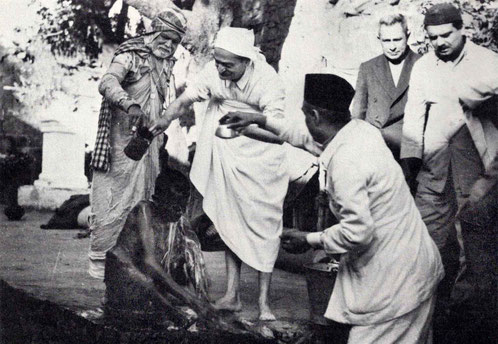 "7th November 1954 : Meher Baba at the leper colony in Pandharpur, washing a leper with Saint Gadge Maharaj  ( behind ) & Pendu Irani assisting ( right of Baba ) with Meherjee Karkaria & Eruch Jessawala. Photo by B. Panday. Courtesy of ""The Beloved""-p.72."