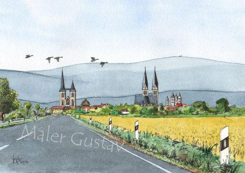 Auf dem Bild sind die Martinikirche, der Wasserturm, der Dom zu Halberstadt und die Liebfrauenkirche zu sehen. Im Hintergrund ist der Harz mit seinem höchsten Berg, dem Brocken, zu erkennen.  Das Tor zum Harz.