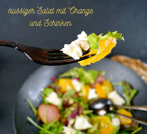 bunter Salat mit Rucola, Orangen, Haselnüssen, Mozzarella und selbst geräuchertem Schinken