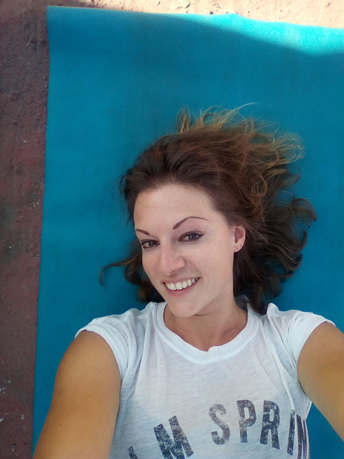 Taken on the rooftop at the community where I lived after my own Yoga practices. I was really happy in that moment.