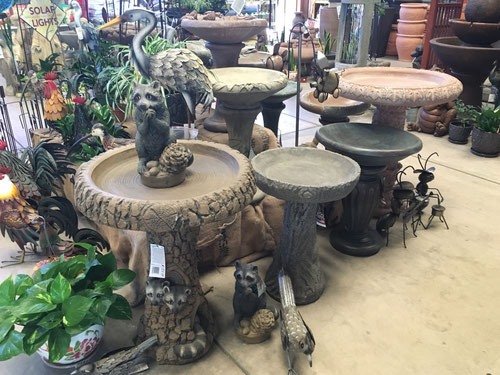 Raccoon birdbath from Fiore Stone