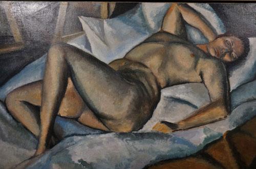 """Dezsó Orban.Desnudo femenino.1911.En los artistas de vanguardia llamados """"buscadores"""" tiene una presencia destacada el desnudo en un entorno reducido al mínimo y esencialmente geométrico.El cuerpo en diagonal se retuerce con tensión dinámica."""