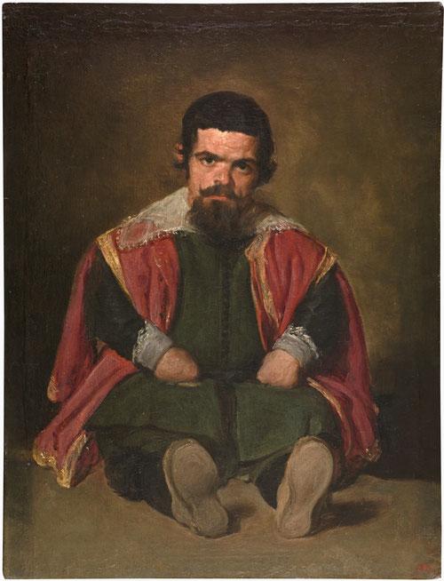 Diego Velázquez.Bufón El Primo 1644.Óleo sobre lienzo 106x82cm.Madrid Museo del Prado.Retrato sedente con las piernas hacia el espectador marca la cortedad del personaje cubierto con ropaje con rico cromatismo.
