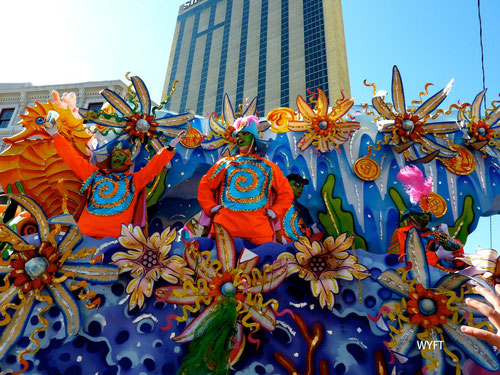 """© Winifred. Mardi Gras Parade, New Orlean. Mardi Gras 2012 is on Feb 21. We were part of this mother of all parades and celebration in 2010. It was wild, colourful, full of energy and fun! """"Give me something sir!"""""""