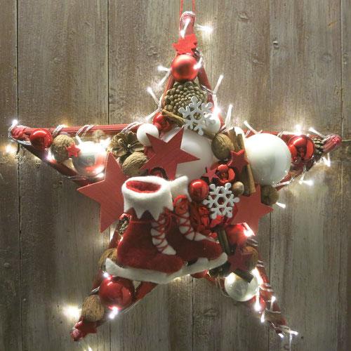 Rot-weißer Stern mit eingearbeiteter Lichterkette, zum einfach in die Steckdose stecken.