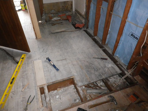 The laundry pipes had been leaking, so some floor was chopped out and moved about a bit