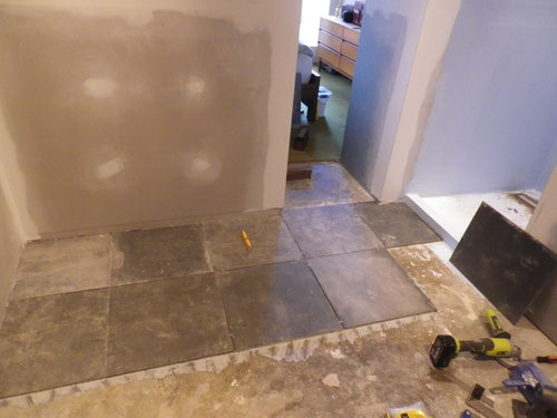 Starting the tiling, lined up off the centre of the shower