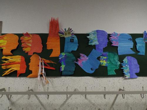 Die Schüler haben ein Schattenporträt von sich angefertigt und sich eine wilde Frisur aus warmen Flammen oder kalten Wellen verpasst.