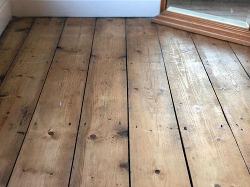 Floor boards hidden under the carpet