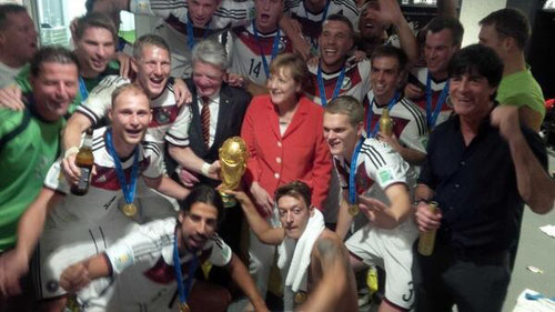 The German national team with chancellor Angela Merkel and the president Joachim Gauck after their world cup win
