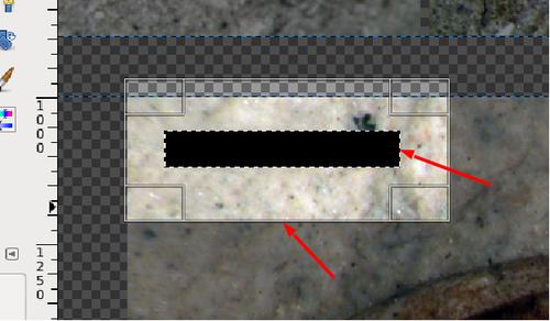 Hier wird die Ebene mit dem Maßstab beschnitten, weil die Ebene die gesamte Blattgröße einnimmt, als einziges Element aber nur den schwarzen Balken enthält. Der ausgemalte Auswahlbereich (rechter Pfeil) wird von einer Beschnittmaske (Pfeil unten) umgeben.