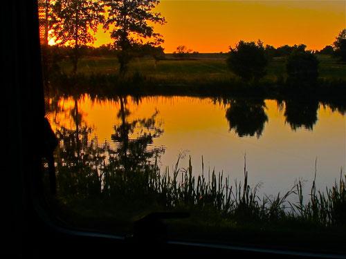 Sonnenuntergang und Weiher......