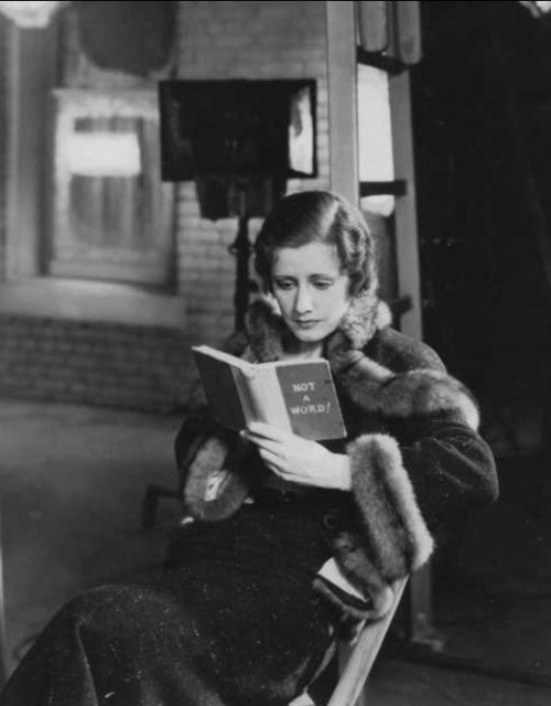 "Irene on the set of ""Back Street"" with her ""mad book."""