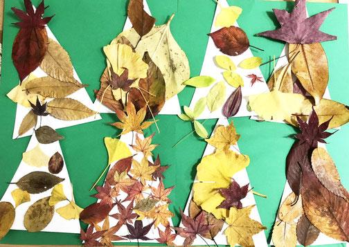 フィオーレコース(2歳児) モンテッソーリ活動でいろいろな落ち葉を貼ってツリーを制作しました