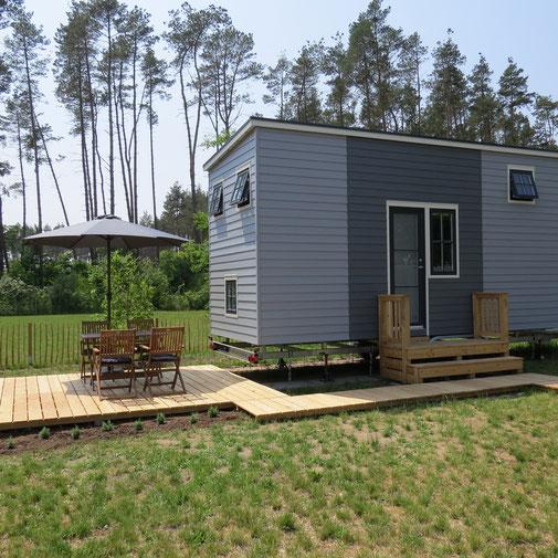 Urlaub am Wald Ferienhaus mit Terrasse mit Badesee zur Entspannung