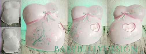 Gipsabdruck vom Babybauch, Babybauchabdruck, Überarbeitung, Oberflächenglättung, Veredelung, Gestaltung, Bemalung, Blumenranke, Ornament, Schnörkel, Baby-Herz, Hintergrundbeleuchtung, Lampe, Leinwand