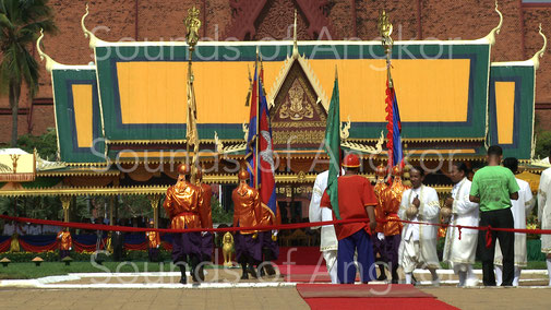 Two priests of the Royal Court of Cambodia holding a conch during the holy furrow festival in 2012.