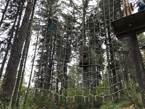 Jump into the net at the challenge course