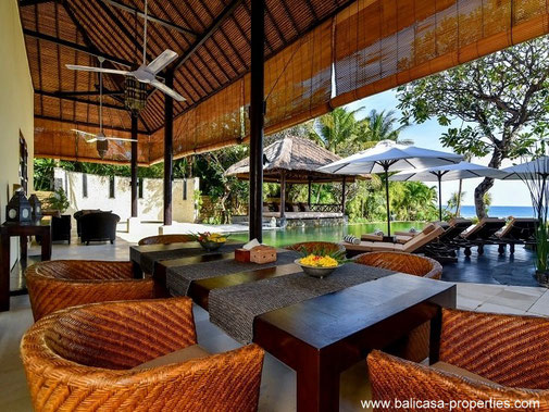 Lovina beachfront villa for sale with 3 bedrooms and a large tropical garden.