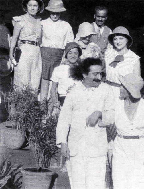 9 April 1933 - Bhandardara, India. Vivienne behind Baba & Mabel Ryan wearing a plinth hat. Delia De Leonis next to her with Margaret Craske behind her. ( Back row L-R ) Audrey Williams, Christine McNaughton & Dr. Ghani Munsiff. Courtesy of Lord Meher.