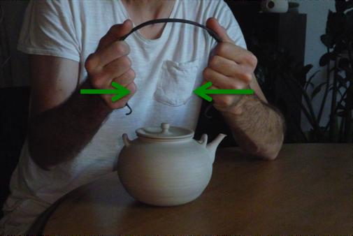 Consignes à faire, pour placer l'anse en fer forgé sur la bouilloire