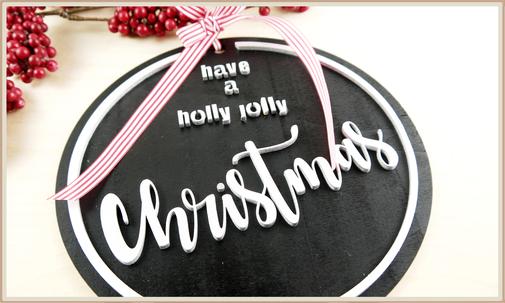 Schild in schwarz-silber, have a holly jolly christmas