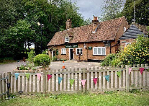 The Elephant and Castle pub in Amwell near Wheathampstead with a fence with bunting.
