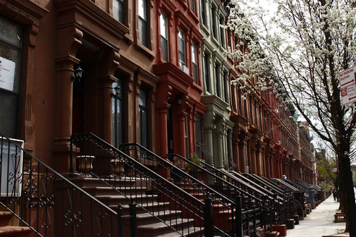 Street in Harlem, New York with adobe houses