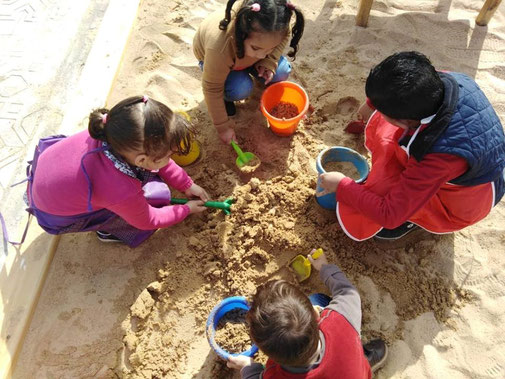 It is fun to play with sand with friends!