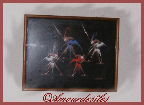 Tableau Africain en relief et en tissu représentant une danse typique...