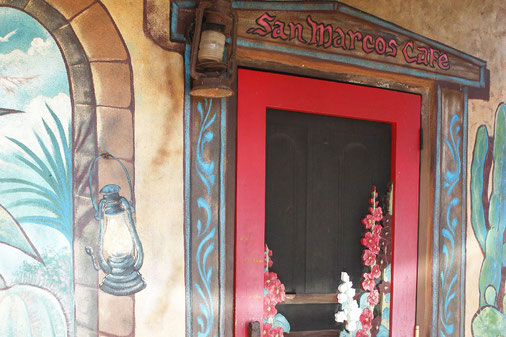 Cafe San Marcos, wooden door with flowers, Turquoise Trail New Mexico