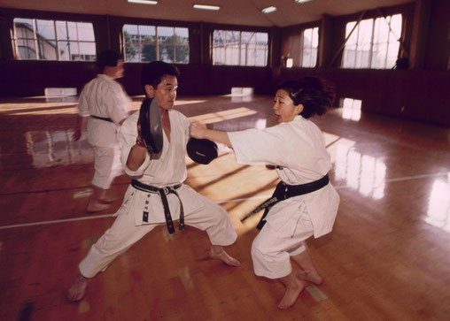 A karateka gives her all in practice; Tokyo, Japan.