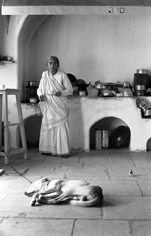 Mansari in her kitchen with one of her dogs - Photographed by Anne Giles